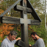 A moment's silence at the cross where a whole village of believers were executed by the NKVD in the 1930s